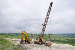 Two different excavator in sand quarry Royalty Free Stock Image