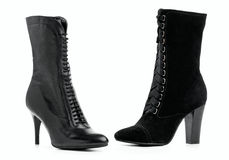 Two different female boots over white Royalty Free Stock Images