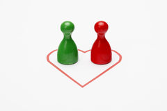 Two different figurines in a heart Royalty Free Stock Photos