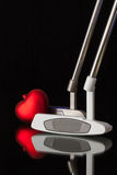 Two different golf putters and red heart Stock Images
