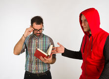 Two different guys. Two very different guys, a nerdy and a funky one Royalty Free Stock Photo