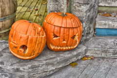Two different Halloween pumpkins. In autumn Royalty Free Stock Photos