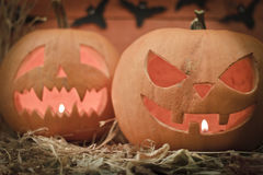 Two different Halloween pumpkins. On autumn background Stock Photography