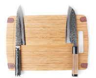 Two different japanese knives on cutting board Stock Photography