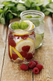 Two different jars with drinks Royalty Free Stock Image