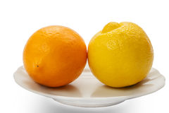 Two different lemon. On a plate Stock Photo