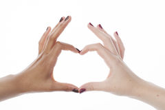 Two different nathion manicured hands on white Royalty Free Stock Photo