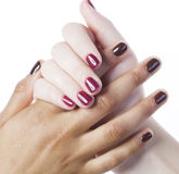 Two different nathion manicured hands on white Stock Image