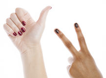 Two different nathion manicured hands on white Royalty Free Stock Photography