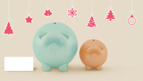 Two different piggy bank with christmas decoration Royalty Free Stock Image
