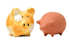 Two different piggy banks Royalty Free Stock Photography
