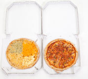 Two different pizzas Stock Photography