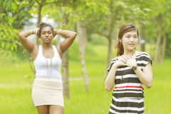 Two different races woman, black and asian. Stock Photography