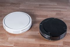 Free Two Different Robotic Vacuum Cleaners, Efficient Dust Absorption In Absence Of Householder, Modern Smart Appliance For Cleaning Royalty Free Stock Image - 160949266