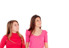 Two different sisters looking up Royalty Free Stock Photos