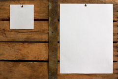 Two different size blank paper. Two pieces of blank paper tacked to wooden background.Ready for your text Stock Photo