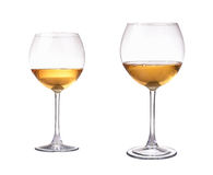 Two different size wineglass with white wine. Concept and idea Stock Photo