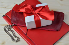 Two different sort of red leather purses and a luxury gift box Royalty Free Stock Image