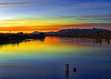 Two different state on either side of one river. Colorful sunset over two different states. one is California and the other is Arizona Divided by the Colorado Royalty Free Stock Photos