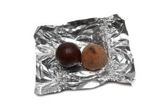 Two different sweets on a foil Royalty Free Stock Photo