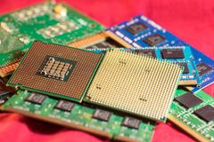 Two CPUs with RAM. Two different types of CPUs on stacks of memory cards Stock Photography