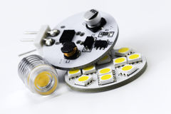 Two different types of G4 LED bulbs and electronics side of led Stock Photo