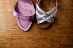 Two different wedding shoes sit side by side stock images