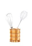 Two different whisks in wooden jar. Stock Image