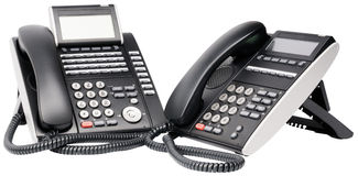 Two digital telephone sets Royalty Free Stock Photo