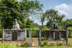 Two dignitary mausolea at domain Raja Tombs, Madikeri India. Madikeri, India - October 31, 2013: Two small white and gray dignitary mausolea with bull statue on stock images