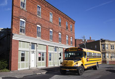 Two Dimension Building. The school bus passing by flat shape building in Saint John town (New Brunswick, Canada Stock Photos