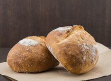 Two Dinner Rolls on Brown Paper Royalty Free Stock Image