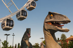 Two dinosaur and a ferris wheel Royalty Free Stock Photos