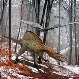 Two Dinosaurs in the forest. Dinosaurs Pteranodon and Spinosaurus at Rasnov Dino Parc, Brasov County, Romania Royalty Free Stock Photos