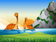 Two dinosaurs in the lake Stock Photo
