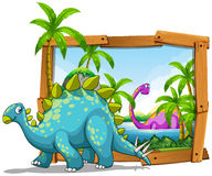 Two dinosaurs in wooden frame Royalty Free Stock Photos