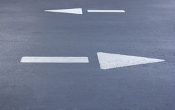 Two directional road arrows Royalty Free Stock Photo