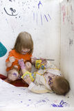 Two dirty children sketching. Two dirty children sketching themselves with a paint Royalty Free Stock Images