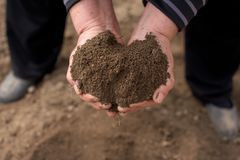 Handful with soil Royalty Free Stock Images