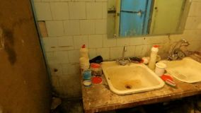 Two dirty, rusty wash basin stock video footage
