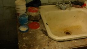Two dirty, rusty wash basin stock video