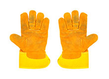 Two dirty yellow work gloves, on white background Stock Photography