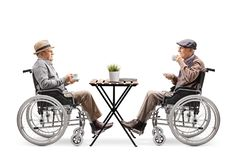 Free Two Disabled Elderly Men In Wheelchairs Drinking Coffee At A Cafe Royalty Free Stock Images - 138557099