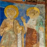 Two disciples with latin texts in a medieval fresco. A romanesque mural in Bjaresjo church, Sweden, November 6, 2009 Stock Images