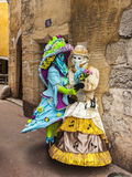 Two Disguised Persons on a Narrow Street Stock Image