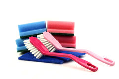 Two dish brushes and some abrasive pads. On a white background Royalty Free Stock Images