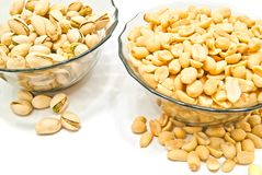 Two dish with different nuts. On white background Stock Image