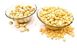 Two dish with nuts closeup. On white background Stock Images