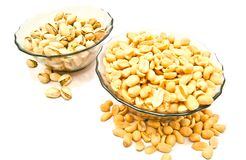 Two dish with tasty nuts. Two dish with nuts on white background closeup Stock Image