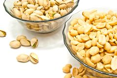 Two dish with yummy nuts. Two dish with different nuts on white Royalty Free Stock Image